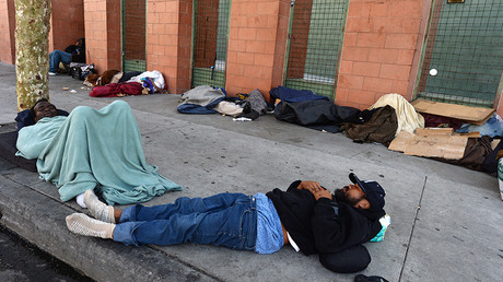 FILE PHOTO: Homeless people sleep on the street, California, USA © Robyn Beck / AFP