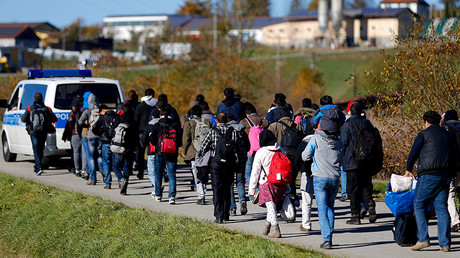 FILE PHOTO: Migrants are escorted by German police to a registration centre, after crossing the Austrian-German border © Michael Dalder
