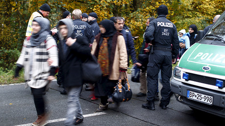 FILE PHOTO: Migrants are cleared by German police officers after crossing the Austrian-German border from Achleiten, Austria, in Passau, Germany © Michaela Rehle