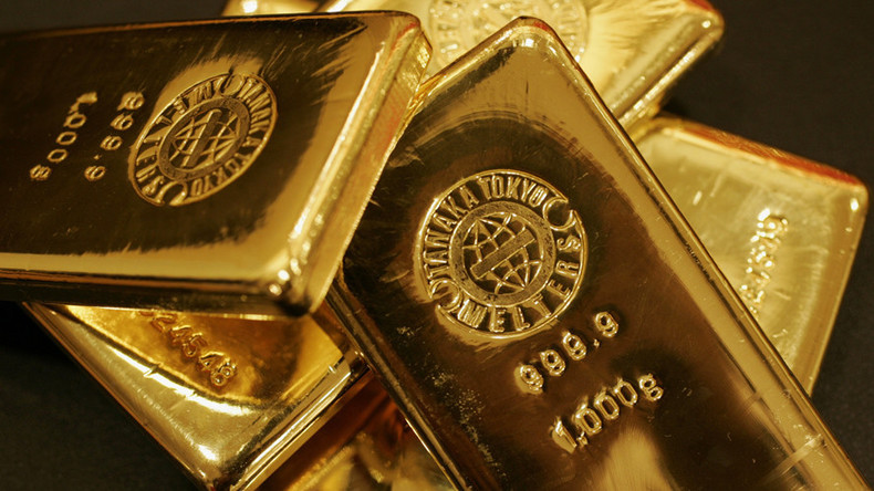 Gold surges to 1-yr high, dollar dips as N.Korea fears grow