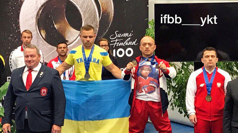 IPF briefly suspends Russian champion powerlifter for 'lucky' Putin t-shirt podium stunt