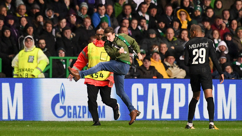 UEFA charges Celtic after fan runs onto pitch & aims kick at PSG striker