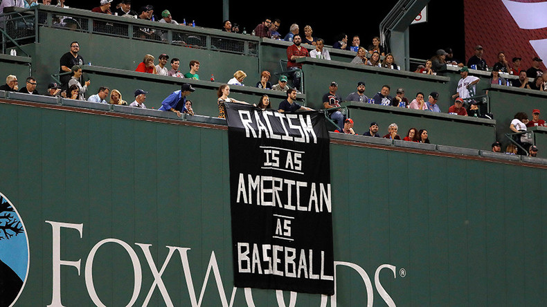 'Racism is as American as baseball': Banner sparks uproar at Red Sox game