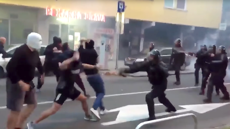 Slovenian hooligans violently clash with police after attempting to attack Russian fans (VIDEO)