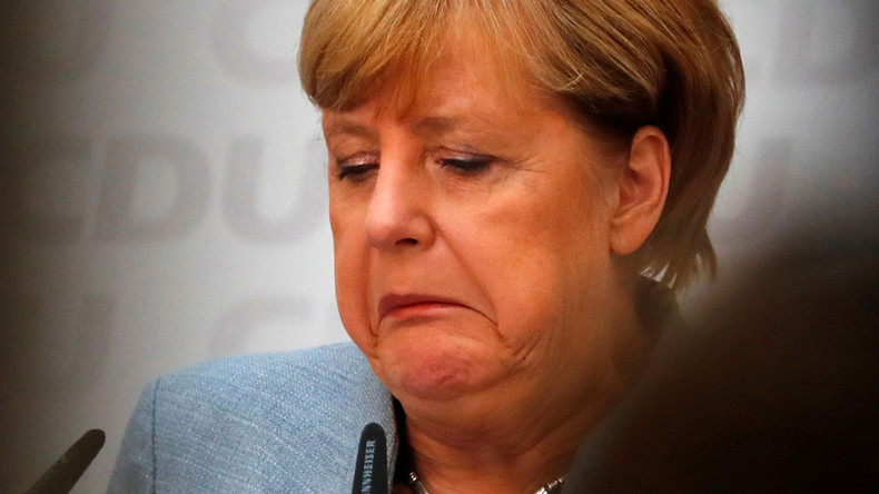 Euro dips after Angela Merkel's hollow victory