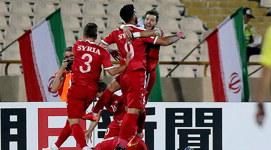 Syria keep Russia 2018 dream alive: War-torn nation earn play off place with dramatic late equalizer