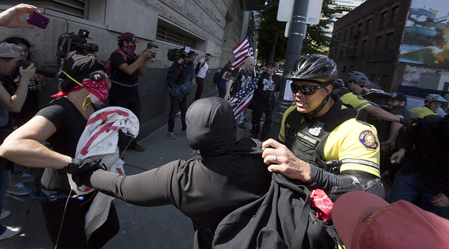Clashes break out over white nationalist's speech at Michigan university