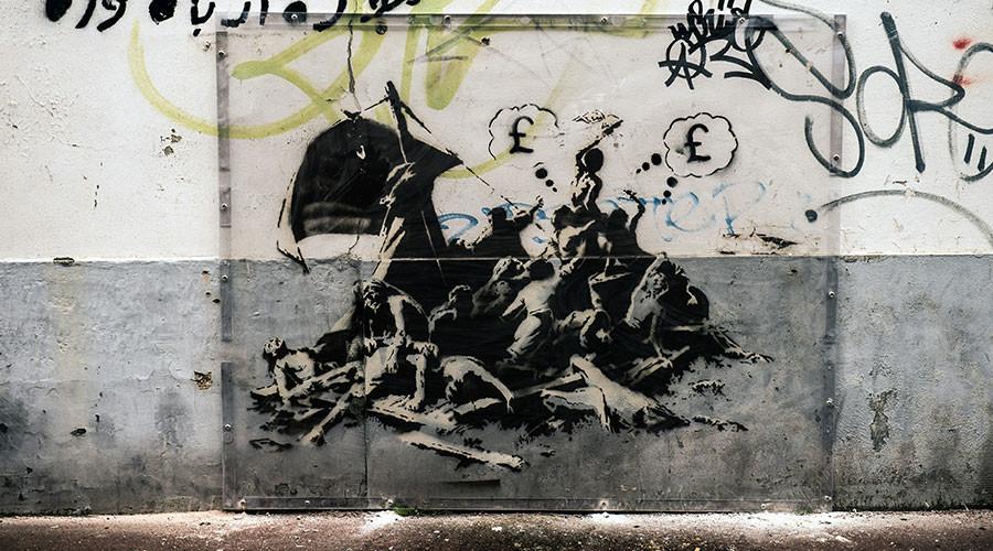 Banksy mural in Calais erased during building revamp (PHOTOS)