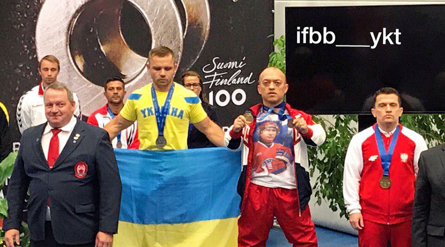 IPF briefly suspends Russian champion powerlifter for 'lucky' Putin t-shirt podium stunt