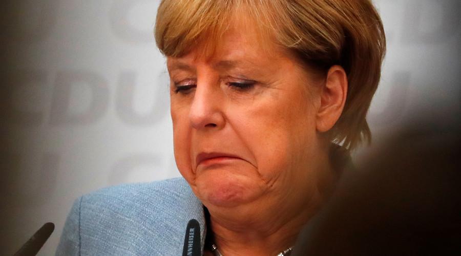 Euro dips after Angela Merkel's hollow victory
