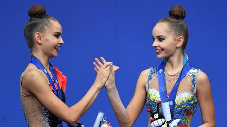 Russian gymnast twins Dina Averina (left) and Arina Averina (right) © Vladimir Pesnya