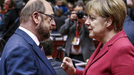 Martin Schulz (L) and German Chancellor Angela Merkel © Yves Herman