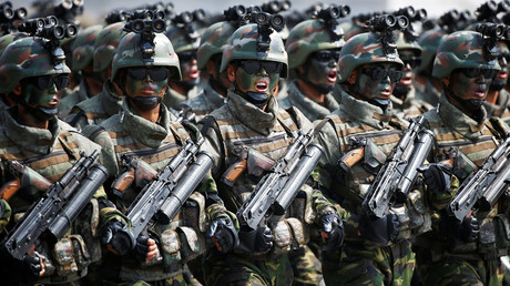 North Korean special forces soldiers march and shout slogans during a military parade © Damir Sagolj