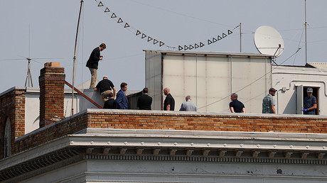 People are seen on the rooftop at the Consulate General of Russia in San Francisco, California, U.S., September 2, 2017 © Stephen Lam