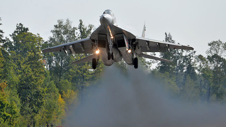 An MiG-29 jet of the Belarus Air Force flies over a runway section of the Minsk-Mogilev highway as part of preparations for the West 2017 Belarusian-Russian joint strategic exercise in the Mogilev Region, Belarus. © Sputnik