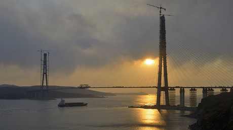 The sun sets behind a bridge under construction linking Russky Island (R) to the mainland, near Russia's far Eastern port of Vladivostok © Yuri Maltsev