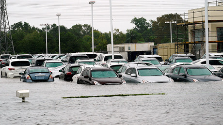 A car dealership is covered by Hurricane Harvey floodwaters near Houston, Texas August 29, 2017. © Rick Wilking