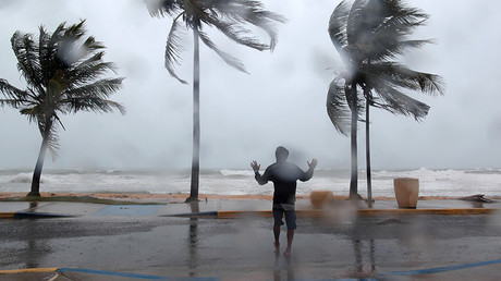 A man reacts in the winds and rain as Hurricane Irma slammed across islands in the northern Caribbean on Wednesday, in Luquillo, Puerto Rico September 6, 2017. © Alvin Baez