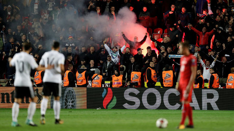 Germany fans celebrate their second goal with a flare © David W Cerny