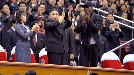 North Korean leader Kim Jong-Un (C), his wife Ri Sol-Ju (L) and former NBA basketball player Dennis Rodman © Reuters