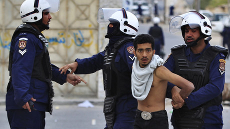 FILE PHOTO Riot policemen arrest an anti-government protester during clashes in Manama © Ahmed Jadallah