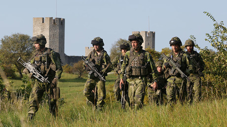 FILE PHOTO: Swedish military patrol outside Visby, island of Gotland, Sweden September 14, 2016. © TT News Agency / Soren Andersson