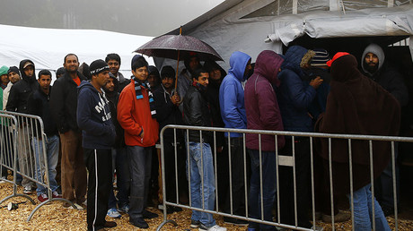 Migrants queue to get into a food tent at a temporary registration centre in the village of Schwarzenborn, northeast of Frankfurt, Germany. ©Kai Pfaffenbach