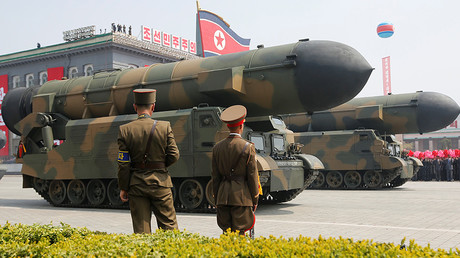 FILE PHOTO: Missiles are driven past the stand with North Korean leader Kim Jong Un during a military parade, Pyongyang. © Sue-Lin Wong