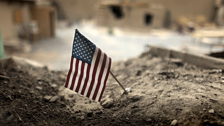 FILE PHOTO: An American flag is placed in a dirt-filled barrier, at Combat Outpost Nolen, north of Kandahar. © Bob Strong