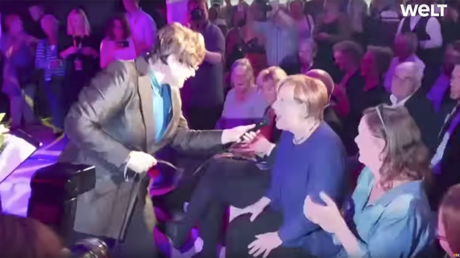 'Strange things happen every day:' Merkel sings at election event (VIDEO)