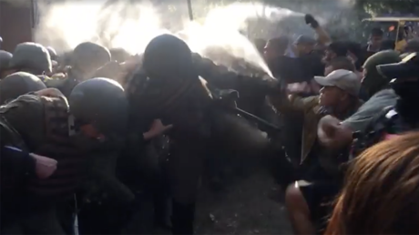 Ukrainian nationalists battle police outside court after anti-Maidan activists declared 'not guilty'