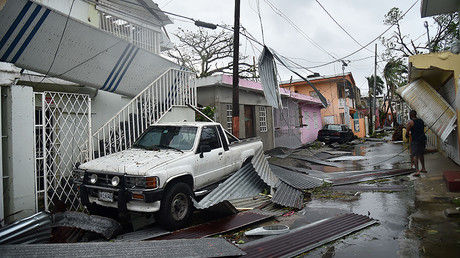 Residents of San Juan, Puerto Rico, deal with damages to their homes on September 20, 2017, as Hurricane Maria batters the island. © Hector Retamal