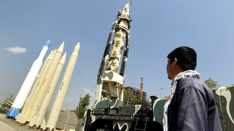 A man looks at Iranian-made missiles at Holy Defence Museum in Tehran © Raheb Homavandi