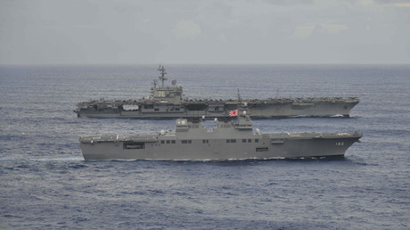 USS Ronald Reagan sails with Japan Maritime Self-Defense Force destroyer Ise during their joint military drill in the sea off Japan © apan Maritime Self-Defense Force