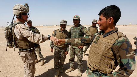A U.S. Marine (L) shakes hand with Afghan National Army (ANA) soldiers during a training exercise in Helmand province, Afghanistan. © Omar Sobhani