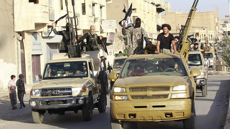 FILE PHOTO: Militant Islamist fighters in military vehicles parade along the streets of Syria's northern Raqqa province © Reuters