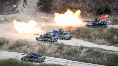 FILE PHOTO South Korean Army K1A1 and U.S. Army M1A2 tanks fire live rounds during a U.S.-South Korea joint live-fire military exercise © Kim Hong-Ji
