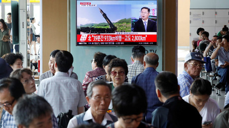 People watch a TV broadcasting still photographs released by North Korea's state-run television KRT of North Korea's Hwasong-14 missile at a railway station in Seoul © Kim Hong-Ji
