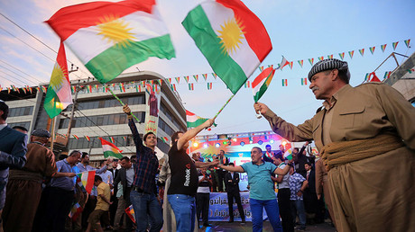 Kurds celebrate to show their support for the independence referendum in Duhok, Iraq, September 26, 2017. © Ari Jalal