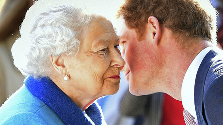 FILE PHOTO: Britain's Queen Elizabeth greets her grandson Prince Harry © Julian Simmonds