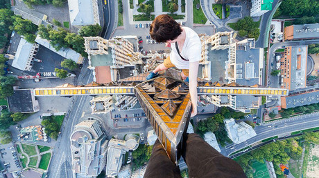 An urban climber at the top of Kudrinskaya Square Building, Moscow © Alexander Voskresensky