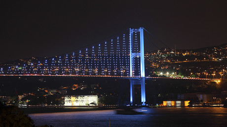 The Bosphorus Bridge that links the city's European and Asian sides is illuminated in Istanbul © Murad Sezer