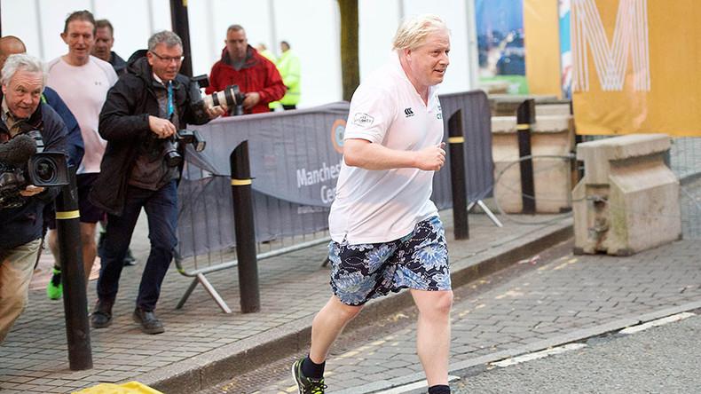 Murdoch's new favorite? Embarrassing snap shows Boris Johnson jogging with Sun editor