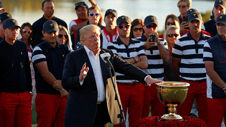 Trump dedicates golf trophy to hurricane victims ahead of Puerto Rico visit (VIDEO)