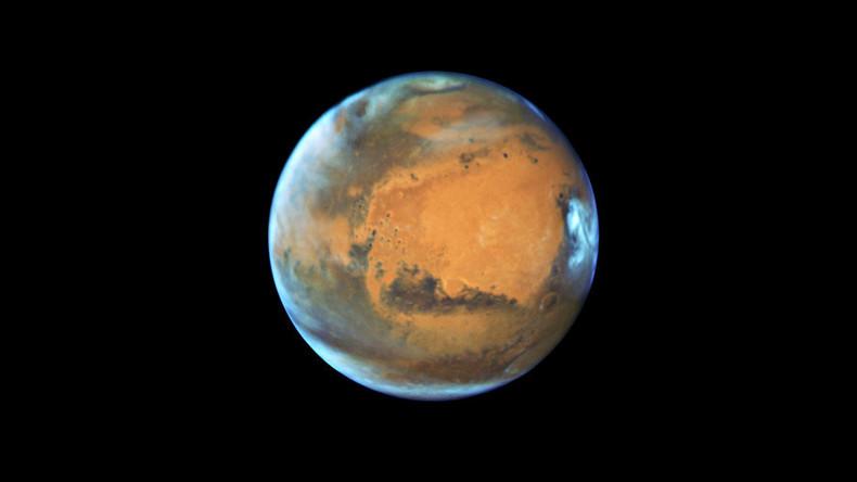 Epic Martian solar storm sparks global aurora, doubles planet's radiation levels (IMAGES)