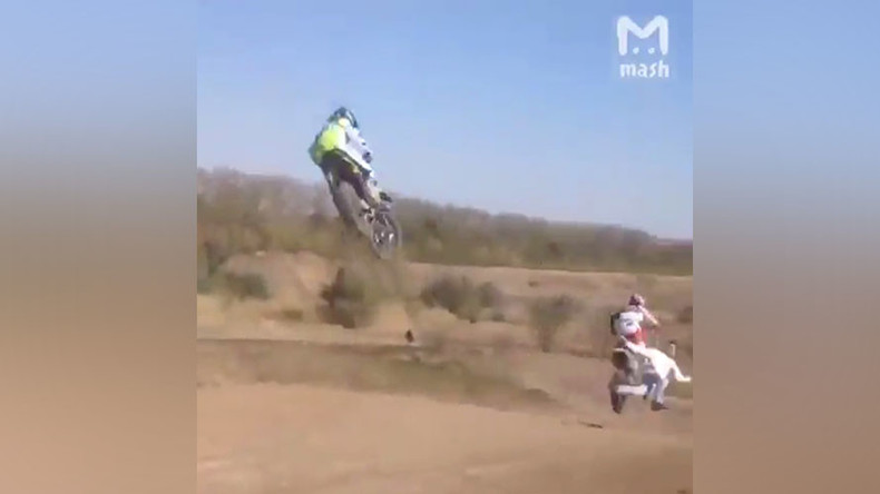 Fan dies after being hit by motocross bike while attempting to run across track (VIDEO)