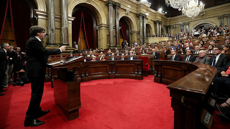 Catalonia signs 'declaration of independence,' temporarily suspends it for dialogue with Madrid