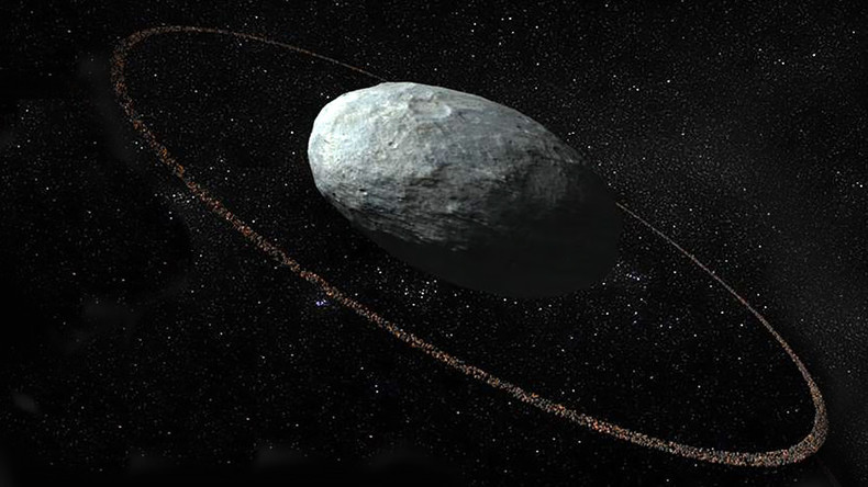 Astronomers spot ring around pebble-shaped dwarf planet