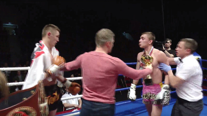 Kickboxer attacks opponent after losing, chases angry fan (VIDEO)