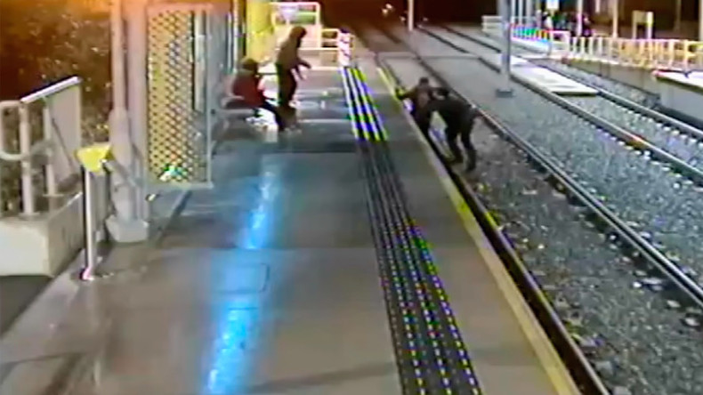 Horrific CCTV footage shows man drop-kicked off train platform (VIDEO)